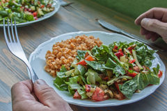 Bon Appetit. Red lentils served in the company of multi-colored salad. Very healthy meal consisting of protein, vitamins and minerals needed for good health Royalty Free Stock Photos