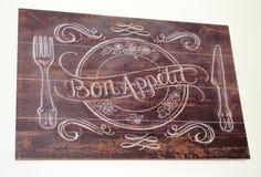 Bon Appetite envejeció al tablero de madera Imagen de archivo libre de regalías