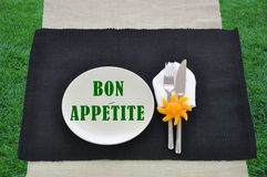 Bon Appetite Text on Plate silverware grass Stock Photography