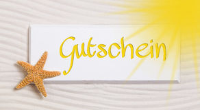 Bon de voyage avec le mot allemand pour un chèque-cadeaux Photos libres de droits
