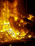 Bon Fires burn during the annual Celebration of Las Fallas, Valencia, Spain Stock Photo