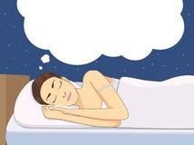 Bon rêve sur un lit Image libre de droits