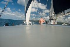 Bon voyage. People sailing on catamaran at sea Stock Photography