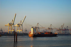 Bon voyage. Cargo Ship is leaving Harbour of Hamburg royalty free stock photo