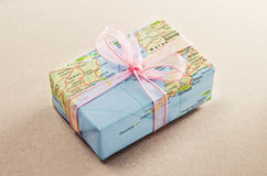Bon voyage gift. Gift with world map wrapping paper Stock Images