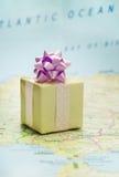 Bon voyage gift. Wrapped gift on Europe map Stock Image