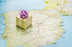 Bon voyage gift. Wrapped gift on Europe map Stock Photography