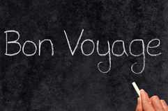 Bon Voyage, have a good trip. Bon Voyage, have a good trip, written on a blackboard Stock Photos