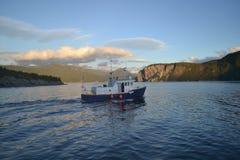 Bon Voyage!. Mid-day cruise on the Atlantic ocean in Newfoundland, Canada Stock Photo