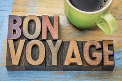 Bon Voyage in wood type. Bon Voyage  - travel concept in vintage letterpress wood type blocks stained by color inks Stock Images