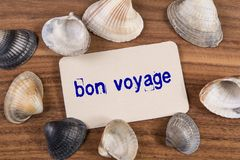 Bon voyage word. Write in card on wood background Stock Photos