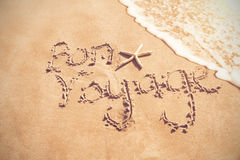 Bon voyage written on sand. At beach Royalty Free Stock Image