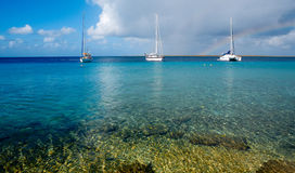 Bonaire. Sailing boats on Bonaire in vibrant Colors-rainbow in sky royalty free stock photography