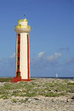 Bonaire Lighthouse. A sailboat passes the the Willemstoren lighthouse on Bonaire, Dutch Antilles royalty free stock photography