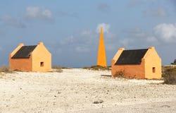 Bonaire`s Historical Obelisks and Slave huts. Bonair`s Obelisks and Slave Huts on the shores of the island stock photography