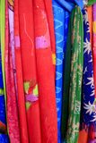 Bonaire Scarve Display. A display of beautiful scarves at an outdoor market in Kralendijk, capital of Bonaire. Colors include red, light blue, green and blue Royalty Free Stock Images