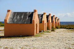 Bonaire Slave Huts. Historic stone slave huts stand on the seaside of Bonaire stock photography