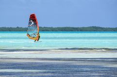 Bonaire, Southern Caribbean - April 12, 2018: Windsurfing in Sorobon Beach in Bonaire, Southern Caribbean. Windsurfing on Colorful Sorobon Beach in Bonaire Royalty Free Stock Images