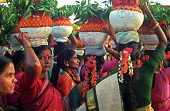 BONALU_ THE FESTIVAL OF MOTHER CULT. The village women standing in front of the holy stone with clay made pitchers on their heads on the occasion of Bonalu Royalty Free Stock Images