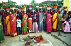 BONALU_ THE FESTIVAL OF MOTHER CULT. The village women standing in front of the holy stone with clay made pitchers on their heads on the occasion of Bonalu Royalty Free Stock Photo