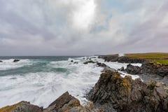 Bonavista Newfoundland. Waves crashing over the rocky shores of Bonavista Newfoundland during a winter storm royalty free stock photo