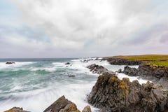 Bonavista Newfoundland. Waves crashing over the rocky shores of Bonavista Newfoundland during a winter storm stock image