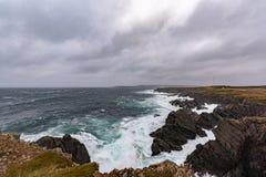 Bonavista Newfoundland. Waves crashing over the rocky shores of Bonavista Newfoundland during a winter storm royalty free stock image