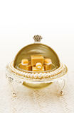 Bonbon holder with candy. Vintage bonbon holder dish with caramel fudge sitting on old lace. This image is exclusive to DT Stock Image