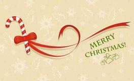 Bonbon mit rotem Bogen, Weihnachtskarte Lizenzfreies Stockfoto