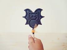 Bonbons à chocolat sur un bâton Photographie stock libre de droits