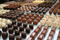 Bonbons. Display with white, beige, brown bonbons Stock Image