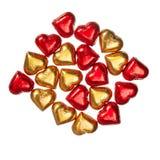 Bonbons au chocolat rouges et jaunes sur le blanc Photographie stock