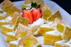 Bonbons avec des fraises Photo stock