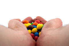 Bonbons in hands Royalty Free Stock Image