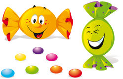 Bonbons with happy smile. Orange and green bonbon with happy smile Royalty Free Stock Images