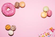 Bonbons, Hintergrund, Macaron-Donut lizenzfreie stockfotos