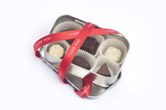 Bonbons in a metal box. With ribbon Royalty Free Stock Photo
