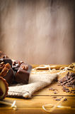 Bonbons stacked on burlap sack on wood table vertical compositio Stock Photo