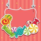 Bonbons sur des chaînes de caractères Photographie stock libre de droits