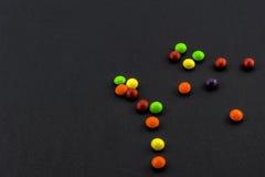 Bonbons sur le noir Photographie stock