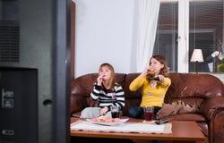 Bonbons und Fernsehapparat Lizenzfreie Stockfotos