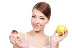 Bonbons und gesunde Nahrung Stockbild