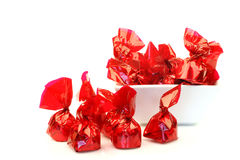 Bonbons wrapped in red shiny paper Royalty Free Stock Image