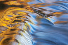 Bond Falls Cascade. Captured with motion blur and illuminated by reflected color from sunlit autumn maples and blue sky overhead, Michigan's Upper Peninsula Stock Photos