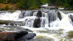 Bond Falls River Rapids. River rapids at Bond Falls Scenic Area in the northwoods of Michigan stock footage
