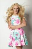Bond female posing in summer dress Stock Images