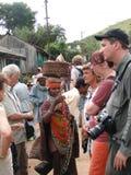 Bonda tribal women and western tourists Royalty Free Stock Photo