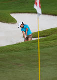 Bondad chips out of bunker at LPGA Malaysia. Australian Frances Bondad chips out of the bunker on Day 1 of the Sime Darby LPGA Golf Tournament on October 22 Stock Image