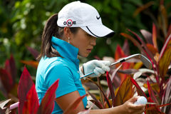 Bondad looks for her ball at LPGA Malaysia Stock Photos