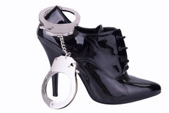 Bondage concept. Handcuffs and high heel, isolated on white background Stock Photos